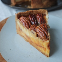 Pecan Pie Cheesecake with Brown Butter Pastry and a Caramel Core